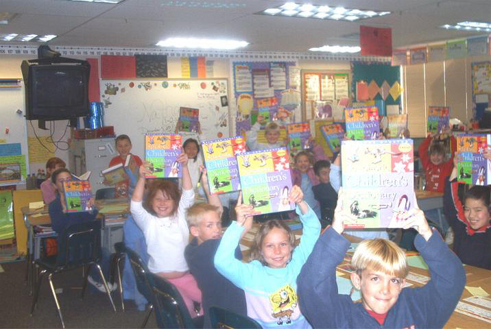 KIds-holding-up-books(home1).jpg (KIds-holding-up-book